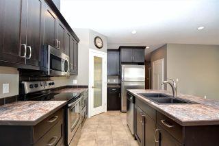 "Photo 3: 11107 104A Avenue in Fort St. John: Fort St. John - City NW 1/2 Duplex for sale in ""SUNSET RIDGE"" (Fort St. John (Zone 60))  : MLS®# R2435468"