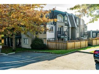 "Photo 1: 90 211 BEGIN Street in Coquitlam: Maillardville Townhouse for sale in ""FONTAINE BLEU"" : MLS®# R2538767"
