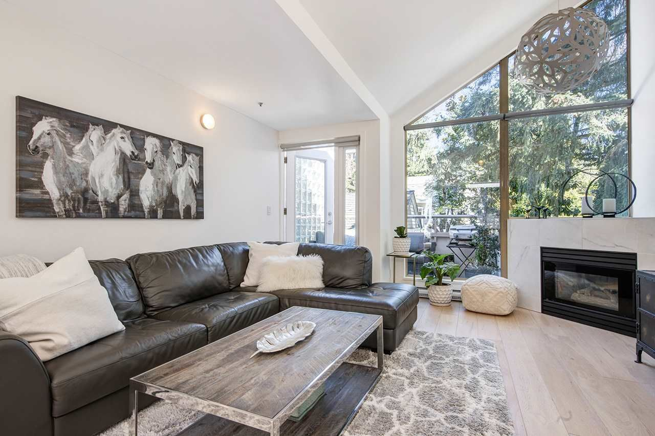 """Main Photo: 205 1871 MARINE Drive in West Vancouver: Ambleside Condo for sale in """"1875 Marine Drive"""" : MLS®# R2566236"""