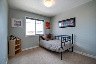 Photo 22: 130 413 River Avenue: Cochrane Row/Townhouse for sale : MLS®# A1112012