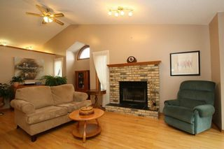 Photo 4: 2 WEST ANDISON Close: Cochrane House for sale : MLS®# C4141938