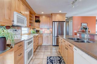 Photo 4: 5535 Dalrymple Hill NW in Calgary: Dalhousie Detached for sale : MLS®# A1071835