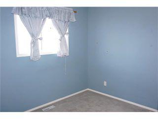 Photo 19: 208 TARINGTON Close NE in Calgary: Taradale House for sale : MLS®# C4040082