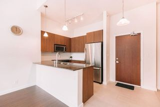"""Photo 2: 407 225 FRANCIS Way in New Westminster: Fraserview NW Condo for sale in """"THE WHITTAKER"""" : MLS®# R2621652"""