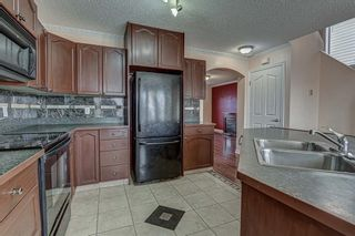 Photo 12: 64 Eversyde Circle SW in Calgary: Evergreen Detached for sale : MLS®# A1090737