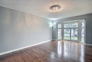 Photo 7: 23 Castlefall Way NE in Calgary: Castleridge Detached for sale : MLS®# A1141276