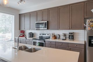 Photo 9: 145 Shawnee Common SW in Calgary: Shawnee Slopes Row/Townhouse for sale : MLS®# A1097036