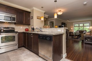 """Photo 2: 206 8084 120A Street in Surrey: Queen Mary Park Surrey Condo for sale in """"THE ECLIPSE"""" : MLS®# R2069146"""
