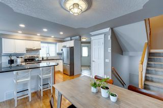 Photo 9: 2107 4 Avenue NW in Calgary: West Hillhurst Row/Townhouse for sale : MLS®# A1129875