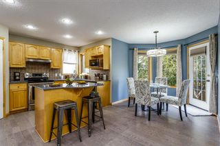 Photo 9: 61 TUSCANY Way NW in Calgary: Tuscany Detached for sale : MLS®# A1034798