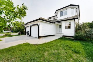 Photo 1: 827 Westmount Drive: Strathmore Semi Detached for sale : MLS®# A1145656
