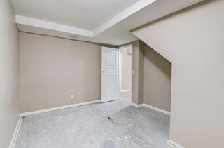Photo 33: 128 Rainbow falls Grove E: Chestermere Duplex for sale : MLS®# A1154026