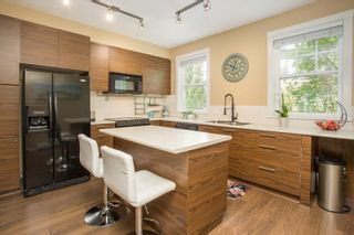 """Photo 3: 23 2495 DAVIES Avenue in Port Coquitlam: Central Pt Coquitlam Townhouse for sale in """"The Arbour"""" : MLS®# R2608413"""