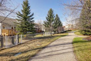 Photo 4: 24 SIGNATURE Way SW in Calgary: Signal Hill Detached for sale : MLS®# C4302567