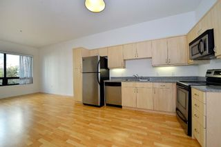 Photo 2: DOWNTOWN Condo for sale : 1 bedrooms : 889 Date #203 in San Diego