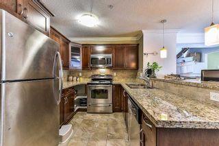 Photo 2: 406 8084 120A Street in Surrey: Queen Mary Park Surrey Condo for sale : MLS®# R2216840