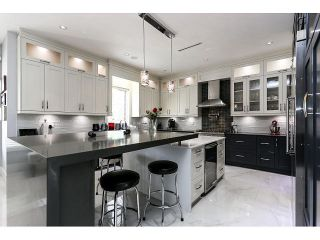 Photo 5: 4038 RUMBLE ST - LISTED BY SUTTON CENTRE REALTY in Burnaby: Suncrest House for sale (Burnaby South)  : MLS®# V1122974