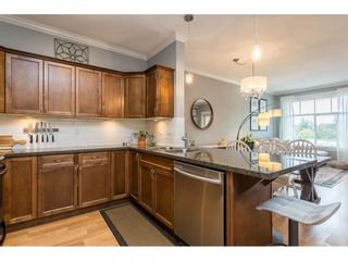 """Photo 5: 401 33338 MAYFAIR Avenue in Abbotsford: Central Abbotsford Condo for sale in """"THE STERLING"""" : MLS®# R2617623"""