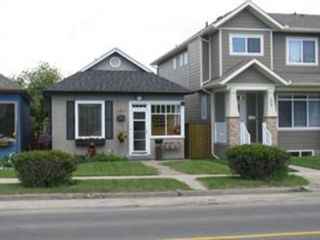 Main Photo: 210 20 Avenue NW in Calgary: Tuxedo Park Detached for sale : MLS®# A1153799