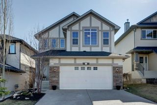 Photo 1: 102 Crestbrook Hill SW in Calgary: Crestmont Detached for sale : MLS®# A1100140