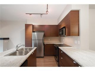 """Photo 1: 38 19478 65TH Avenue in Surrey: Clayton Condo for sale in """"Sunset Grove"""" (Cloverdale)  : MLS®# F1406717"""