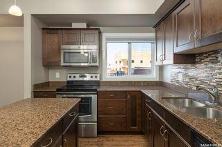 Photo 4: 101 110 Hampton Circle in Saskatoon: Hampton Village Residential for sale : MLS®# SK870724