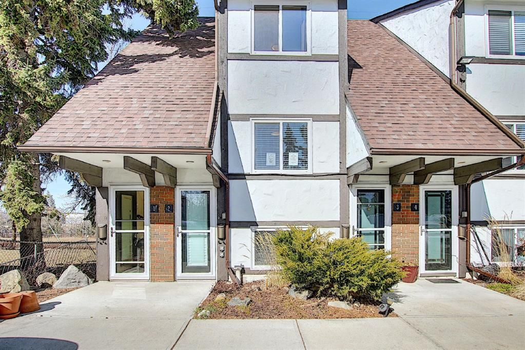 Main Photo: 2 304 Cedar Crescent SW in Calgary: Spruce Cliff Row/Townhouse for sale : MLS®# A1153924