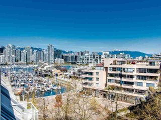 "Photo 1: 303 673 MARKET Hill in Vancouver: False Creek Townhouse for sale in ""MARKET HILL TERRACE"" (Vancouver West)  : MLS®# R2509909"