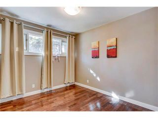 Photo 18: 5612 LADBROOKE Drive SW in Calgary: Lakeview House for sale : MLS®# C4036600