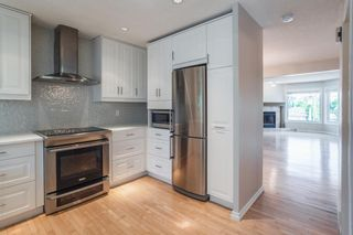 Photo 6: 1407 1 Street NE in Calgary: Crescent Heights Row/Townhouse for sale : MLS®# A1121721