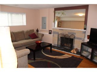 Photo 4: 1491 COMO LAKE AV in Coquitlam: Harbour Place House for sale : MLS®# V979371