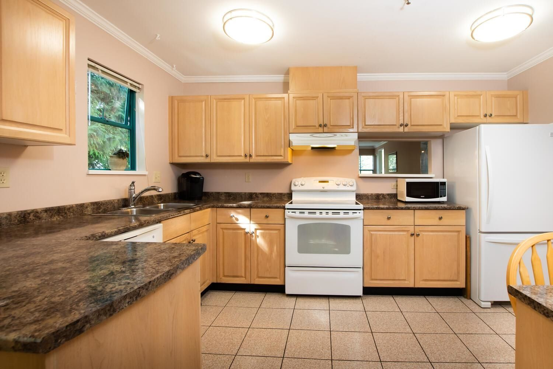 "Main Photo: 303 5550 14B Avenue in Delta: Cliff Drive Condo for sale in ""HIGHLAND TERRACE"" (Tsawwassen)  : MLS®# R2617529"