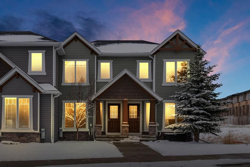 Main Photo: 1562 93 Street SW in Calgary: Aspen Woods Row/Townhouse for sale : MLS®# A1085332
