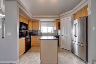 Photo 7: 108 Evermeadow Manor SW in Calgary: Evergreen Detached for sale : MLS®# A1142807