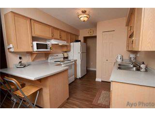 Photo 2: 103 1150 DUFFERIN Street in Coquitlam: Eagle Ridge CQ Condo for sale : MLS®# V1043500
