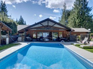 Photo 1: 7117 SECHELT INLET Road in Sechelt: Sechelt District House for sale (Sunshine Coast)  : MLS®# R2578615