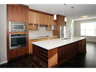 Photo 7: 199 Panatella Square NW in Calgary: Panorama Hills Townhouse for sale : MLS®# C3646555