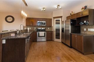 Photo 3: 30 WEST POINTE Manor: Cochrane House for sale : MLS®# C4150247