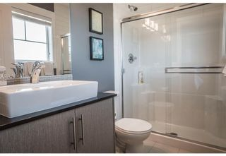 Photo 13: 95 West Coach Manor SW in Calgary: West Springs Row/Townhouse for sale : MLS®# A1114599