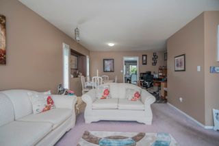 Photo 7: 19383 CUSICK Crescent in Pitt Meadows: Mid Meadows House for sale : MLS®# R2617633