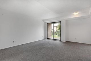 Photo 5: 75 3015 51 Street SW in Calgary: Glenbrook Row/Townhouse for sale : MLS®# A1118534