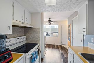 Photo 7: 11 1055 72 Avenue NW in Calgary: Huntington Hills Row/Townhouse for sale : MLS®# A1123870