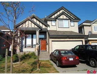 Photo 1: 7077 149A Street in Surrey: East Newton House for sale : MLS®# F2917653