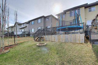 Photo 29: 209 Sunset Common: Cochrane Semi Detached for sale : MLS®# A1104207