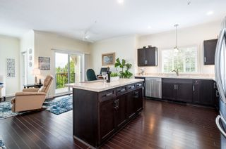"""Photo 13: 411 20281 53A Avenue in Langley: Langley City Condo for sale in """"Gibbons Layne"""" : MLS®# R2621680"""