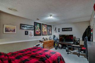 Photo 19: 14 14736 Deerfield Drive in Calgary: Deer Run Row/Townhouse for sale : MLS®# A1092282