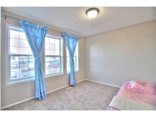 Photo 25: Photos: 606 EVERMEADOW Road SW in Calgary: Evergreen House for sale : MLS®# C4053479