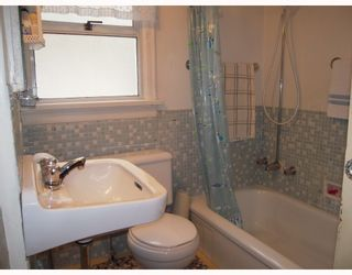 Photo 8: 5215 SLOCAN Street in Vancouver: Collingwood VE House for sale (Vancouver East)  : MLS®# V812437