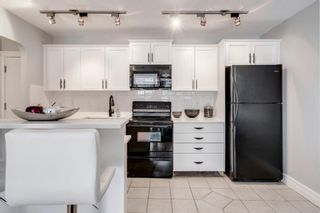 Photo 2: 103 920 Royal Avenue SW in Calgary: Lower Mount Royal Apartment for sale : MLS®# A1088426