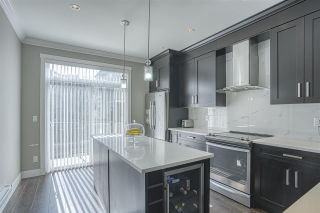 """Photo 1: 107 13670 62 Avenue in Surrey: Sullivan Station Townhouse for sale in """"Panorama South 62"""" : MLS®# R2450811"""